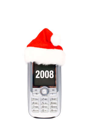 Cellular mobile phone with a red christmas hat on a white background photo