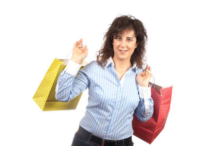A woman holding several shopping bags, isolated on white background Stock Photo - 2005010