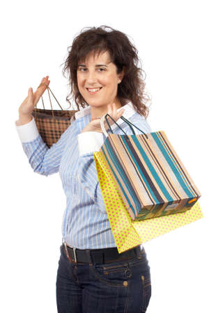 A woman holding several shopping bags, isolated on white background photo