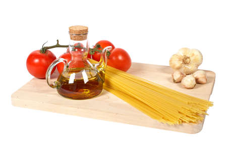 Tomatoes, olive oil, garlic and spaghetti, isolated on white background photo