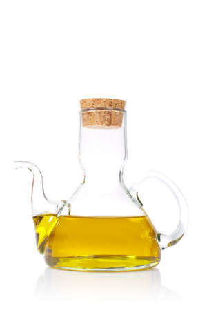 Extra virgin olive oil reflected on white background
