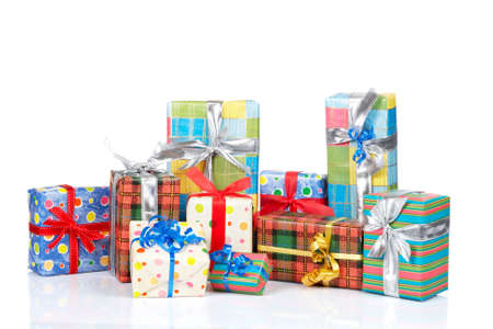 Assortment of gift boxes, reflected on white background photo