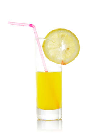 A glass of orange juice with a lemon slice and straw, reflected on white background photo