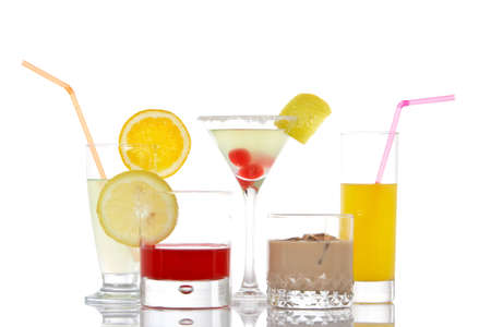 A set of glasses with beverages, reflected on white background