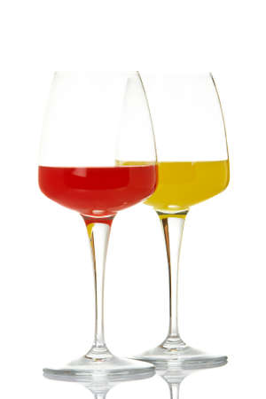 Two glasses with beverages, reflected on white background photo