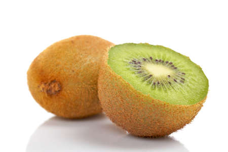 freshest: Two half of kiwi fruit reflected on white background. Shallow DOF Stock Photo