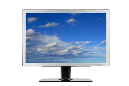 A computer flat wide screen with blue cloudy sky wallpaper, isolated on white background photo