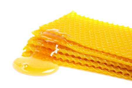 sugary: A honeycomb with honey, reflected on white background Stock Photo