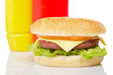 wholegrain mustard: Cheeseburger with mustard and ketchup bottles, reflected on white background Stock Photo