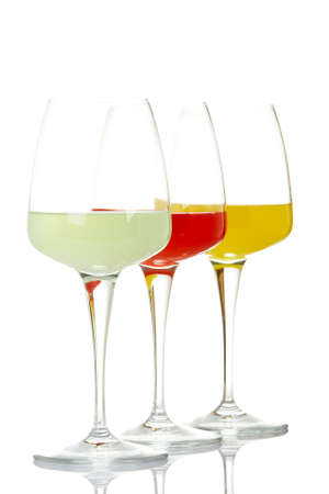 Three glasses with beverages, reflected on white background. Shallow DOF Stock Photo - 2241963