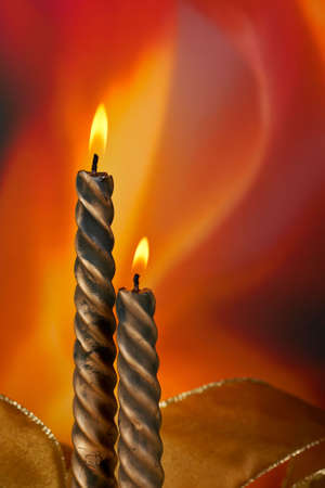 vertical composition: Two christmas candles over color background, vertical composition Stock Photo