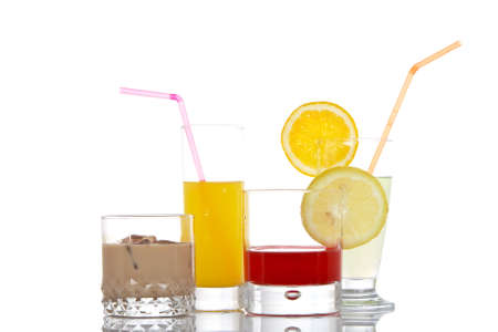 A set of glasses with beverages, reflected on white background photo
