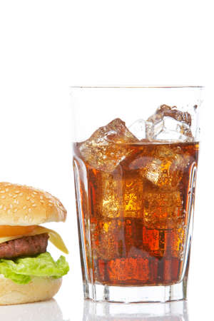 Cheeseburger and soda glass, reflected on white background Banco de Imagens