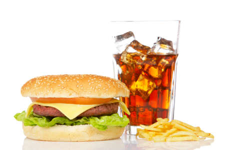 Cheeseburger, soda drink and french fries, reflected on white background. Shallow DOF Banco de Imagens