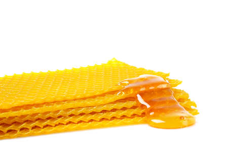 sugary: A honeycomb with honey, soft shadow on white background