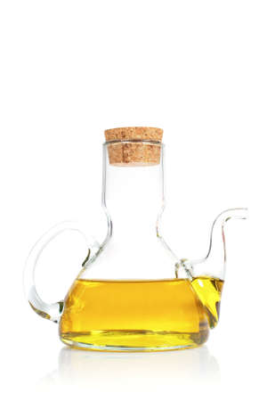 oilcan: Extra virgin olive oil reflected on white background