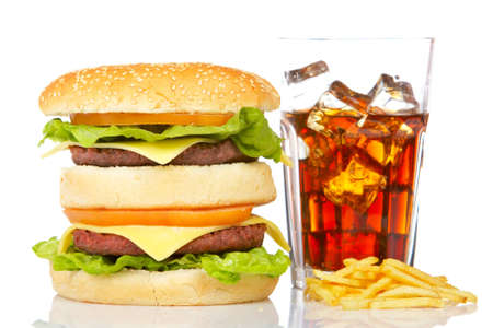junkfood: Double cheeseburger, soda drink and french fries, reflected on white background. Shallow DOF Stock Photo