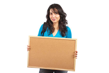 Young student woman holding the empty corkboard on white background photo