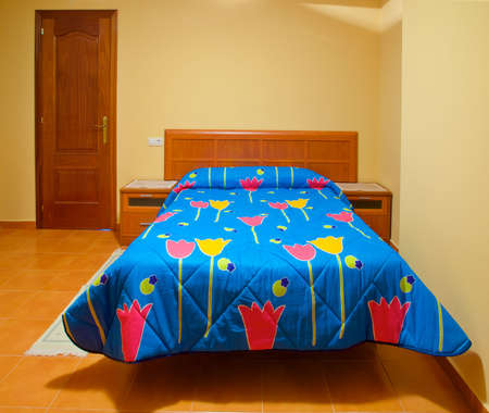 A beautiful empty bed of a small hotel in North of Spain Stock Photo - 2727151