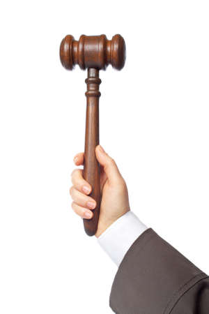 tribunal: Woman judge holding a wooden gavel, isolated on white background