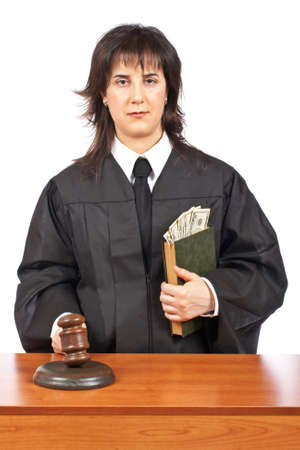 A female judge in a courtroom striking the gavel, accepting a bribe. Shallow depth of field photo