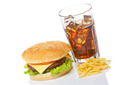 Cheeseburger, soda drink and french fries, reflected on white background.  Stock Photo