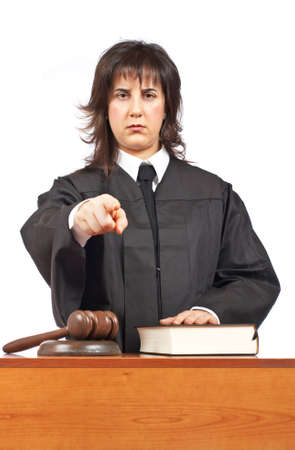 sentencing: Angry female judge pointing at you in a courtroom. Focus on gavel and shallow depth of field