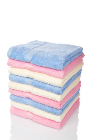 white towel: A multicolored towels stacked and isolated on white background. Shallow depth of file