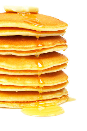 A big stack of pancakes with syrup and butter on focus. Shallow depth of field Stock Photo