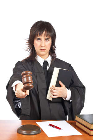 arbitrate: Angry female judge pointing at you in a courtroom. Eyes on focus and blurred gavel