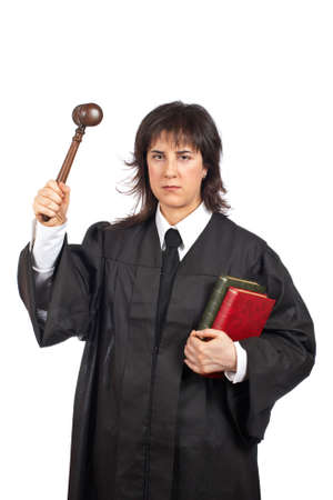 female judge: Angry female judge holding the gavel and books. Shallow depth of field