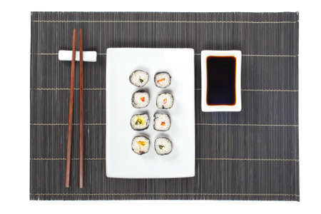 tekka: Sushi on the white plate with soy sauce and chopsticks on bamboo mat