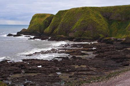 dunnottar castle: Coastal views around Dunnottar Castle near Stonehaven, Scotland Stock Photo