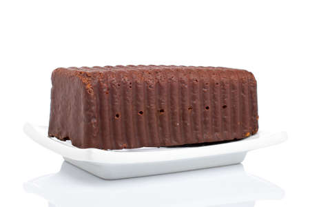 healthful: Chocolate cake on a plate reflected over white background. Shallow depth of field