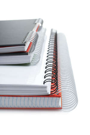 Some notebooks with soft shadow on white background. Shallow DOF Stock Photo - 3273436