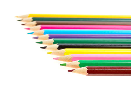 shallow: Assortment of coloured pencils with shadow on white background. Shallow depth of field
