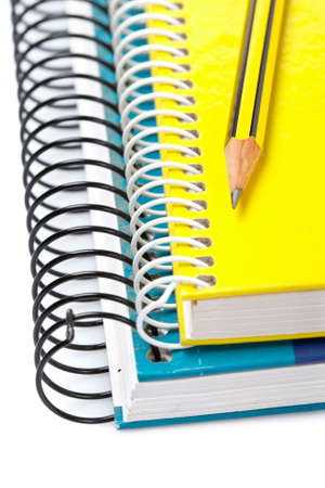 Pencil on a two notebooks with soft shadow on white background. Shallow depth of field Stock Photo - 3283480