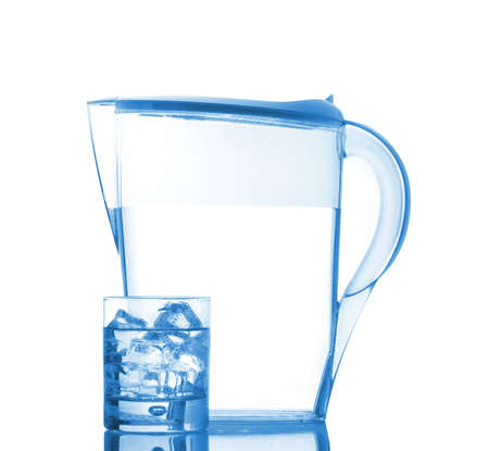 insipid: Pitcher and glass with ice cubes of mineral water reflected on white background