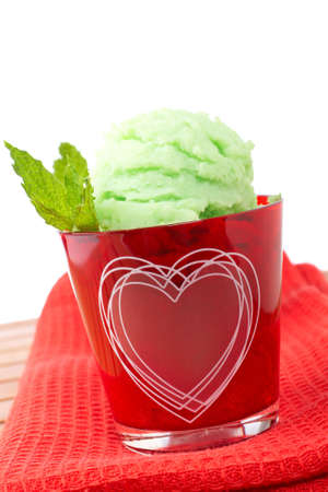 field mint: Delicious mint ice cream in red glass bowl. Shallow depth of field Stock Photo