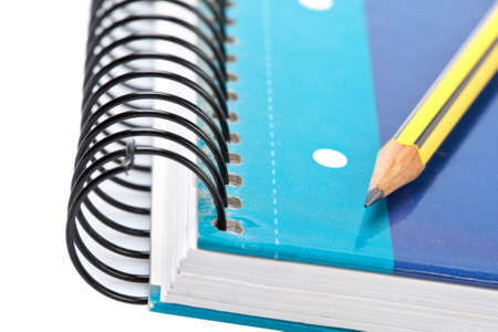 Pencil on a one notebook with soft shadow on white background. Shallow depth of field Stock Photo - 3321134