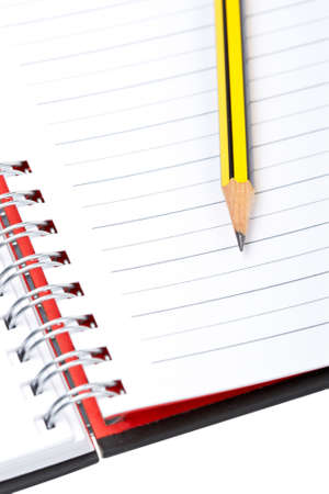 Pencil on a one notebook with soft shadow on white background. Shallow depth of field Stock Photo - 3321129