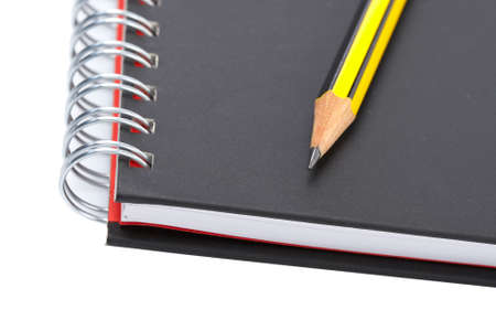 Pencil on a one notebook with soft shadow on white background. Shallow depth of field Stock Photo - 3338210