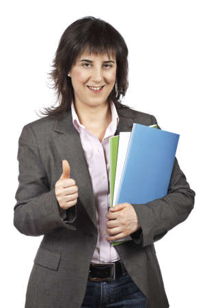 Busy business woman carrying stacked files over a white background photo