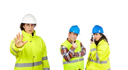 triumphant: Three construction workers over a white background. Focus at front