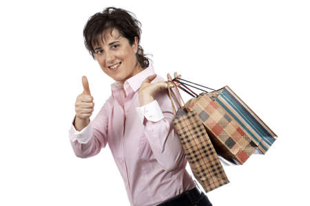 woman handle success: A woman holding several shopping bags, isolated on white background Stock Photo