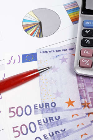 organiser: Calculator, pen and euros on market business financial chart background. Shallow depth of field Stock Photo