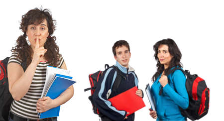 Three students with books and backpacks over a white background. Focus at front photo