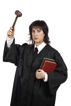 tribunal: Serious female judge holding the gavel and books. Shallow depth of field