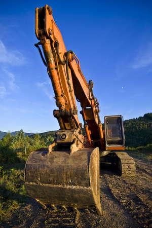 excavate: A big orange bulldozer at construction site Stock Photo