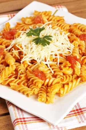 fusilli: Freshly cooked plate of fusilli pasta with tomato sauce just for eating. Shallow depth of field